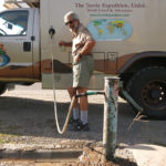 Heading out of town we spotted a neighborhood water faucet and hooked up our handy water thief for a fast fill-up.