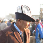 """Gentlemen"" traders at the Karakol Animal Market all seemed to wear this unique style of embroidered felt hat called Kalpak."