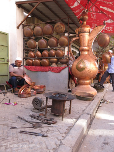 At Kashgar's Copper Market craftsmen were still using traditional hand tools.