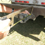 This practical tool called Macs Trail D-Vise is mounted at the rear bumper trailer hitch mount.