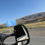 "China was calling and the last road sign we saw said, ""Torugart, 396 kilometers""."