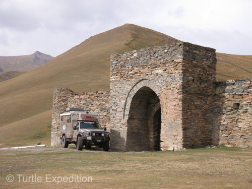 The Turtle V is parked in front of Tash Rabat, a Kyrgyz caravanserai.