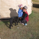 "Tursun, our host & the owner of this home-stay ""yurt hotel"" called Sabrybek's Yurt Camp, poses with her daughter."