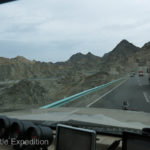 Back on the road, we crossed over a rocky range of low mountains and dropped back down into the Taklamakan desert.