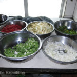 ----the second cook prepared a mixture of all kinds of vegetables and spices which he prepared in a wok.