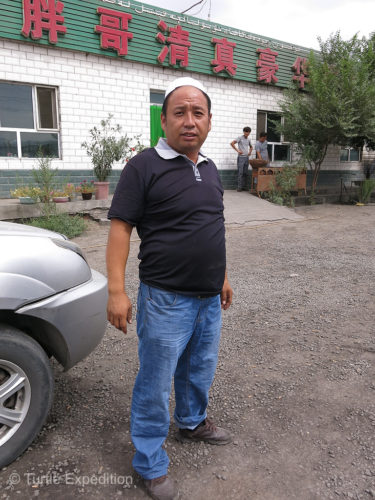 This is the proud owner of the Fat Man Restaurant in Kumux, southwest of Turpan.