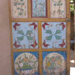 As we wandered through town under the shade of the grape trellises, we admired the are on the doors of homes.