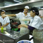Master noodle chefs practice their art. It's a great show and great food.