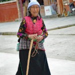 Tibetan Buddhist Pilgrims: We had never seen so many people with canes and brand new tennis shoes.