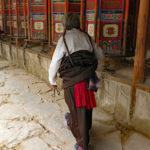 Walking along each prayer wheel gets turned.