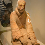 Painted Terracotta figure of a sitting archer cocking his bow, Qin Dynasty