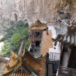 The ornate tile roofs added to the impossibility that the whole structure was hanging from a cliff.