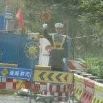 A fake policeman directing traffic.