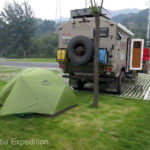 The totally abandoned parking lot made one of our quietest camps on the entire expedition across China. Green slept well in her cozy little MSR tent.