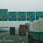 There were some signs that gave Green an idea of where we were going. The sign to Tianjin in 9 km was where we were hoping to reach the ocean but we had to drive much further than that.
