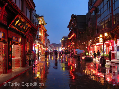 As the sun went down, the lights came up and the beautiful lanterns added to the reflection on the rain-dampened streets.