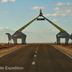 An appropriate monument of camels spans the highway toward Ulaanbaatar, the capital of Mongolia.