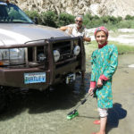 "We were shocked when this young 11-year-old girl waded out into the creek and took the brush from my hands with a look that clearly said ""I don't know who are but I'm going to help."""