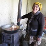 Cooking at Masha's home is done on an old metal stove in an outside porch. The small stove is moved inside in winter and may be their primary source of heat.