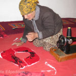 Masha's mother sews many of her children's clothes on a hand-crank sewing machine.