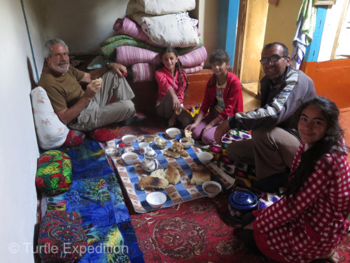 The traditional morning breakfast in the Pamirs is black milk tea with a touch of butter and homemade bread.