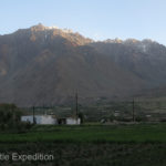 "Surrounded by snow-clad peaks of the Pamirs, the ""village"" is more a community of homes in-between potato and grass fields laced with a web of small interconnected irrigation channels."