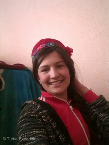 Masha is wearing a traditional Pamiri cap. Men and women seem to wear the same.