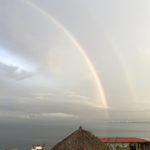 We had never seen a full double rainbow over the ocean. Where was our wide angle lens????