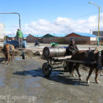 By following a horse-drawn water cart, we were able to fill our own tank with water, one 5-gallon bucket at a time.