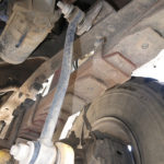 This is what the frame anti-sway bar bracket on the passenger side should have looked like.
