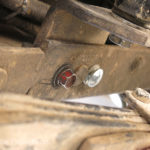 By chance, I had some similar bolts in my emergency-it-will-never-be-needed repair box and we were back on the road.