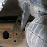 The bolts on the Hellwig air bag bracket on the passenger side were completely gone. Perhaps sheared off by the many potholes and drop-offs. The heavy duty bracket was bent beyond use. It was now pushing on the bottom of the camper box.