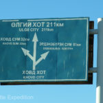 Hey!! A sign we could read. Olgii just 211 kilometers away.