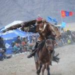 As a wonderful display of the intimate relationship between man, eagle and horse, the competitors then race at top speed past the judges' stand with their eagle enjoying the ride with wings fully extended.