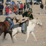 A sheep carcass was tossed on the ground and the riders, two at a time, would pick it up and get a firm grip for an exciting tug-a-war that could last several minutes until one of the riders succeeded in wrestling the bloody carcass away from the other.
