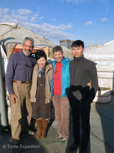 "We posed on the roof top of Gana's Guesthouse in Ulanbaatar with Gana's wife and his son who now helps manage the ""yurt hotel"". Our old friend was off on a fishing trip."