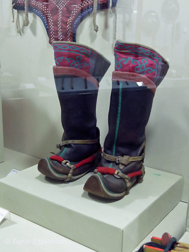 The classic Mongolian boots with toes turned up.