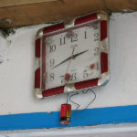 Modern technology: a battery powered clock hung on the wall.