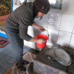The hostess prepares hot tea with fresh milk and a pinch of salt.