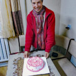 Nazka's husband Tileukhan surprised Monika with a pretty pink birthday cake.