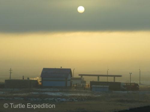 Habitation fog created a moody sunrise.