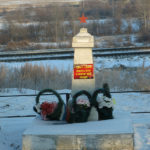We think this is a Monument to a WW II soldier along side the road. A Russian friend just sent the translation: With memories, a soldier stays alive.