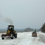 Snowplows were working to keep the road clear but the surface was still treacherously icy with hard packed snow.