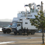 While waiting for customs paperwork at the Donhae Port, our expedition vehicles were inspected by locals.