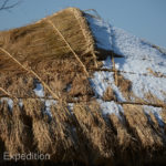 These rice straw roofs are very carefully tied down.