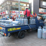 Everyday life - a truck exchanging propane tanks.