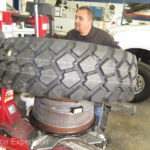 Michelin XZL 335/80R20s are mounted on custom 20X11 Rickson steel wheels. The SmarTire sensor was preinstalled.