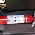 On the side of each seat a Kiddy Safety Halotron fire extinguisher is securely mounted.
