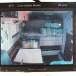 Instead of the non-used rear view mirror, a 5-inch monitor controls our three Total Vision remote cameras; front bumper, rear and one inside the camper. A switch allows us to toggle between the three cameras on the road.