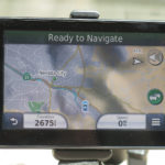 Visible from both driver and passenger, a Garmin GPS supplies navigation information.